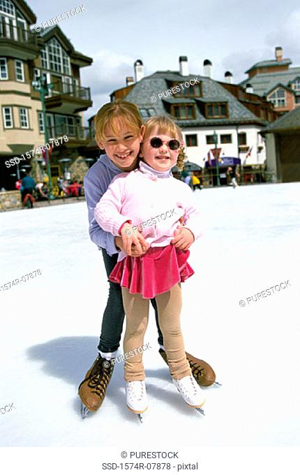 Portrait of two girls ice skating