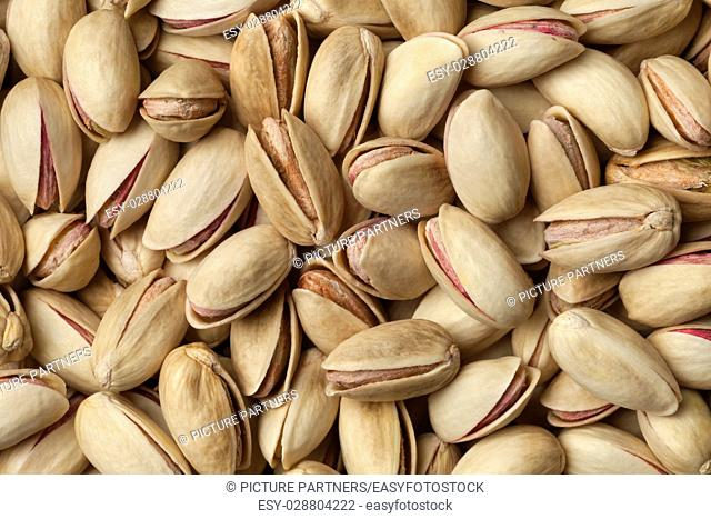 Raw unshelled pistachio nuts full frame