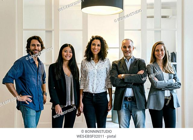 Group of confident business people standing in office
