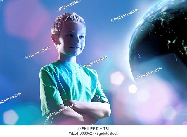 Smiling young boy watching earth