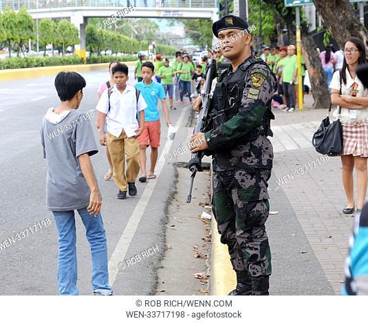 Protestors voice their opinion against Philippine president Rodrigo Duterte in Cebu City Featuring: Filipino soldier Where: Cebu City