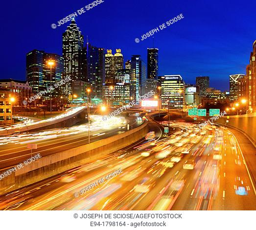 Skyline view of Atlanta, Georgia with rush hour traffic in foreground at dusk