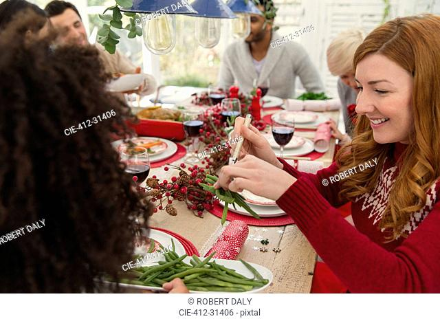 Woman serving green beans at Christmas dinner