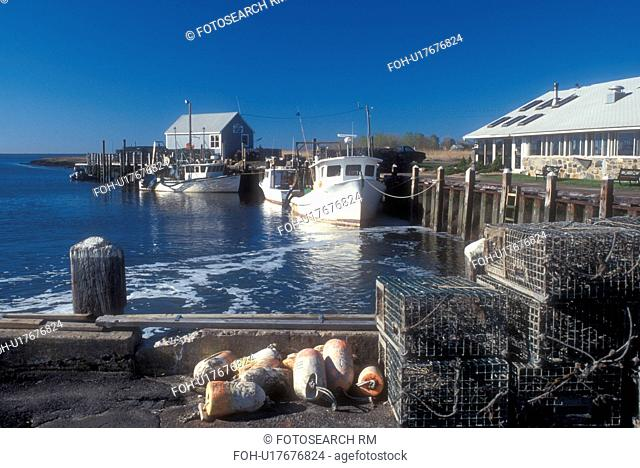 Connecticut, Lobster traps and fishing boats docked in the harbor in Guilford, Connecticut