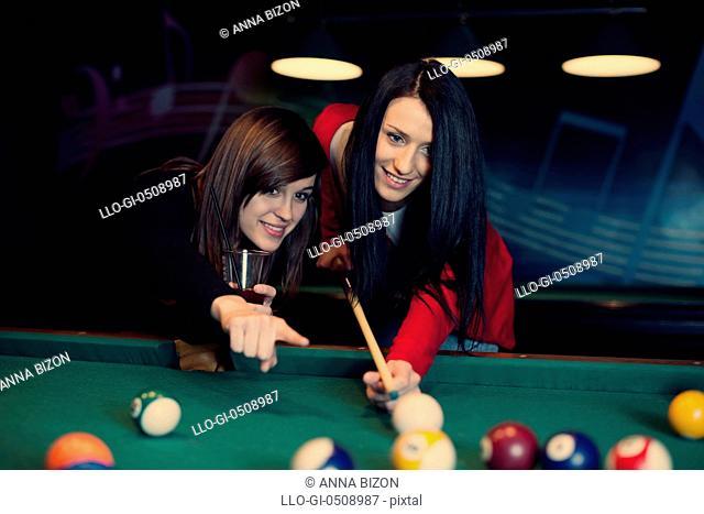 Two girls playing pool game Debica, Poland