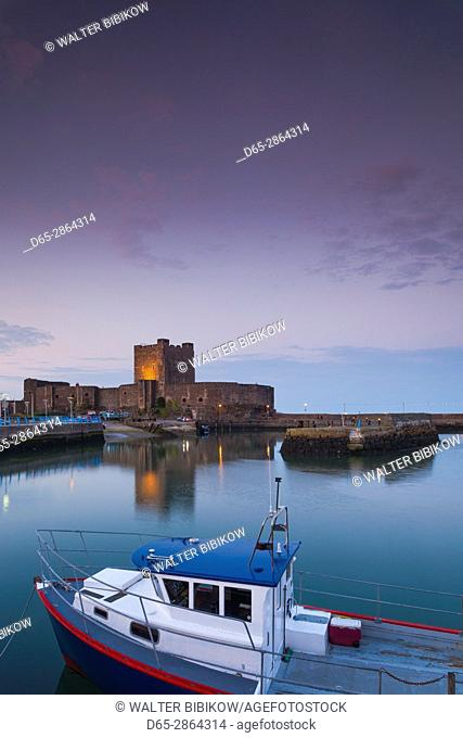 UK, Northern Ireland, County Antrim, Carrickfergus, Carrickfergus Castle, 1177, Ireland's oldest Norman castle, dusk