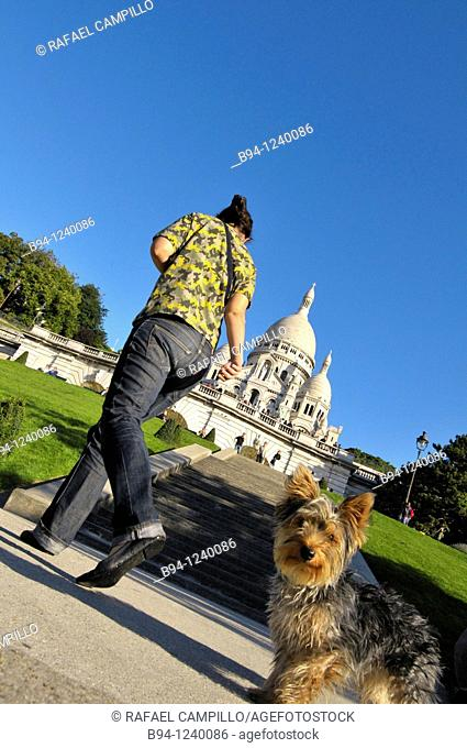 Woman and dog in front of the Basilica of the Sacred Heart, Montmartre, Paris, France