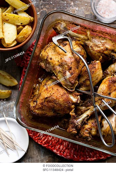 Oven-roasted chicken legs with potato wedges