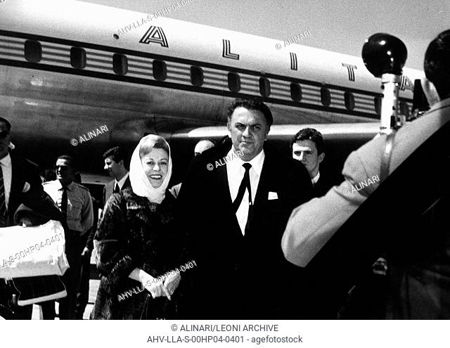 Giulietta Masina and Federico Fellini in front of an Alitalia airplane, shot 1950-1955 ca. by Leoni, Luigi