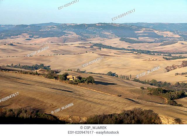 The hills around Pienza and Monticchiello just after sunrise. Tuscany, Italy