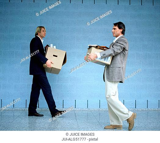 Executives carrying boxes