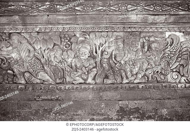 Singaraja temple, A forest scene on the first storey of the entrance to the temple showing human figures & syncretic animal. Bali Indonesia