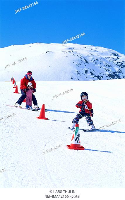 Children learning how to ski