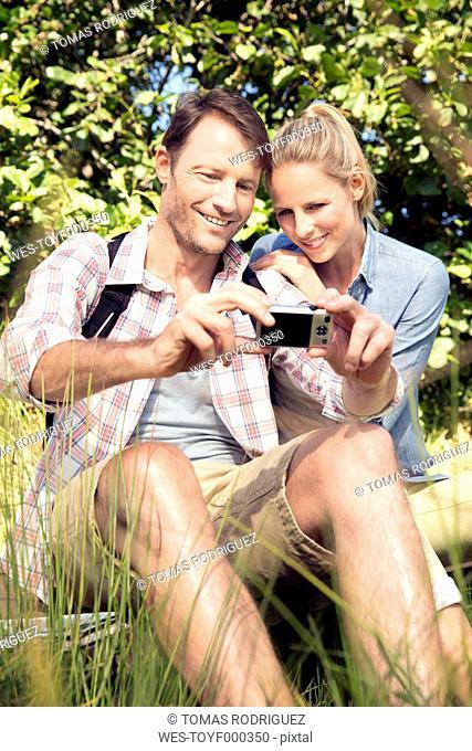 Happy couple in rural landscape taking a selfie