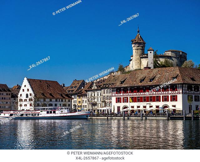 View above the Rhine river on the promenade with the restaurant Güterhof and the fortress Munot, Old Town, Schaffhausen, Canton Schaffhausen, Switzerland