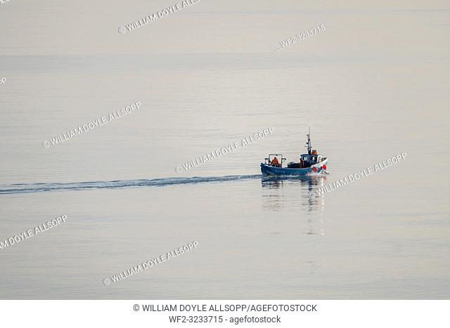 A fishing boat on a calm sea off the North East coast of England