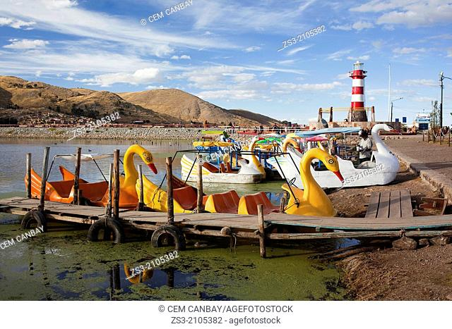 Pedal boats for rent at the harbour, Puno Region, Lake Titicaca, Peru, South America