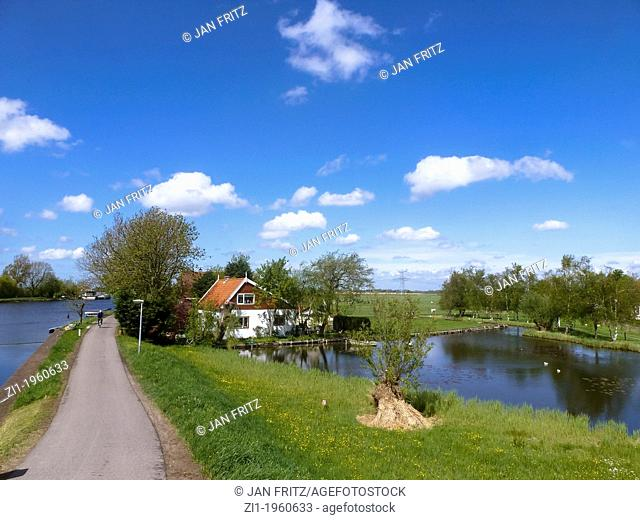 farm with pond in the northwest of the Netherlands