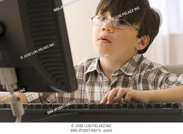 Greek boy looking at computer