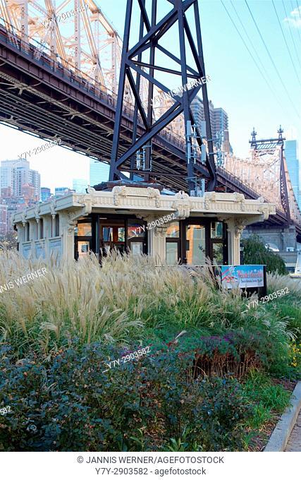 Visitor center underneath Roosevelt Island Funicular and Queensboro Bridge on Roosevelt Island, New York, NY, USA