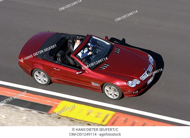 Mercedes SL 500, ruby colored, model year 2006-, driving, diagonal from the side\page\ / oben, Test track