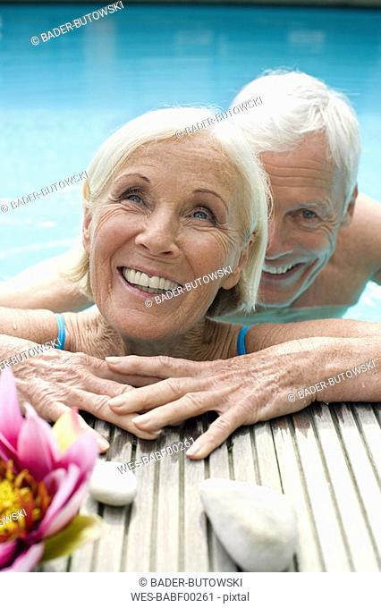 Germany, Senior couple in pool, close-up