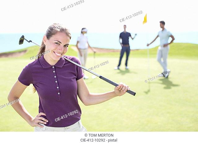 Woman smiling on golf course