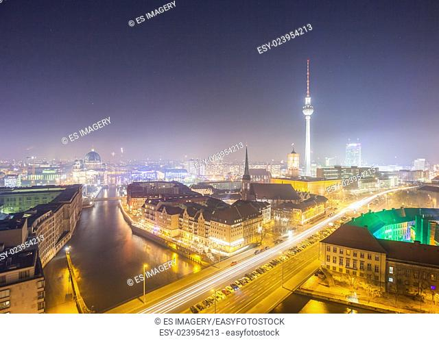 View over Berlin Alexanderplatz at night with fog and haze