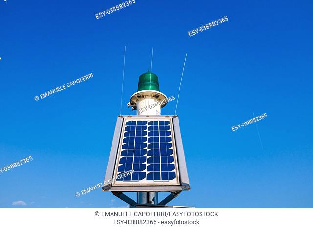 solar panel for lake harbor lighthouse energy, blue sky