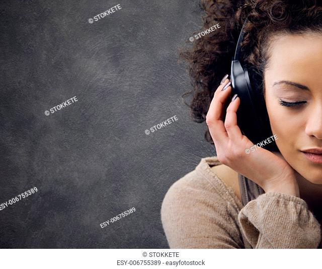 young beautiful woman enjoying music