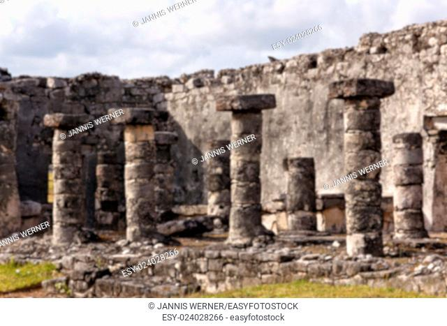 Blurred background of Mayan ruins with columns at the archeological site in Tulum, Quintana Roo, Mexico