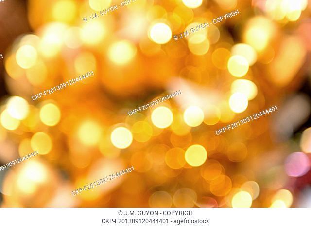 Glittering golden Christmas background blurred