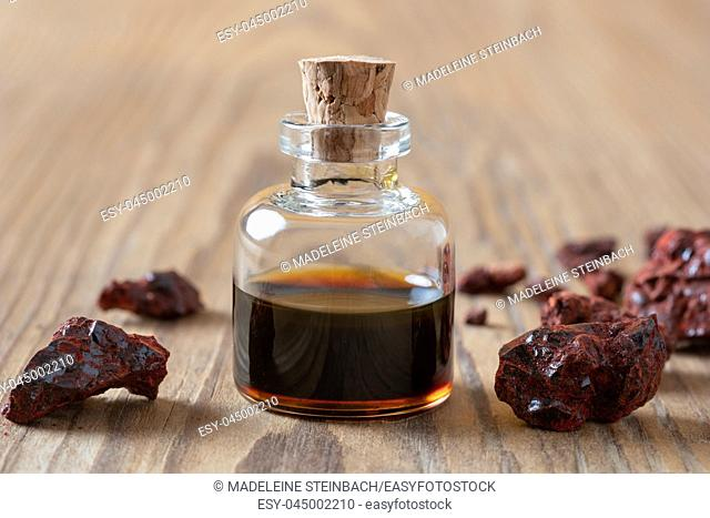 Croton lechleri or sangre de drago resin and oil on a table