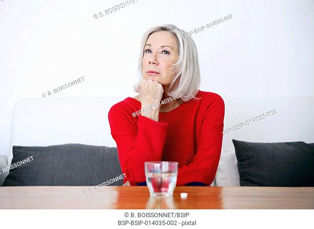 Elderly person with medication