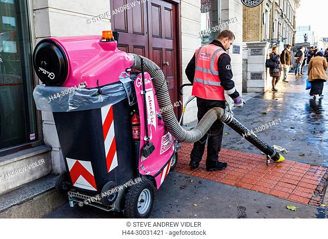 England, London, Southwark, Bankside, Street Cleaner Using Electric Cleaning Machine