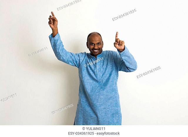 Indian male dancer performs folk dance