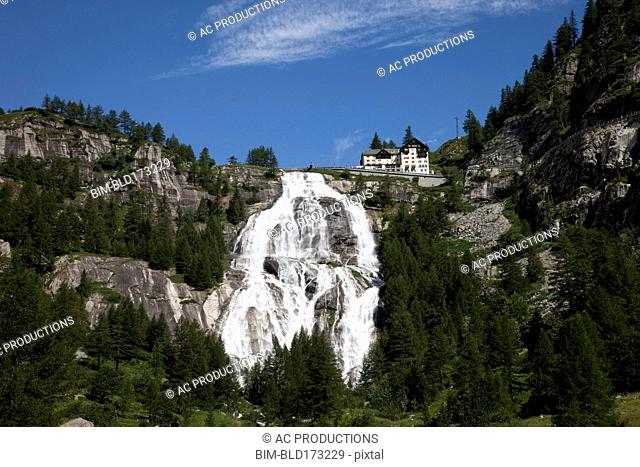 Building over waterfall on remote hillside