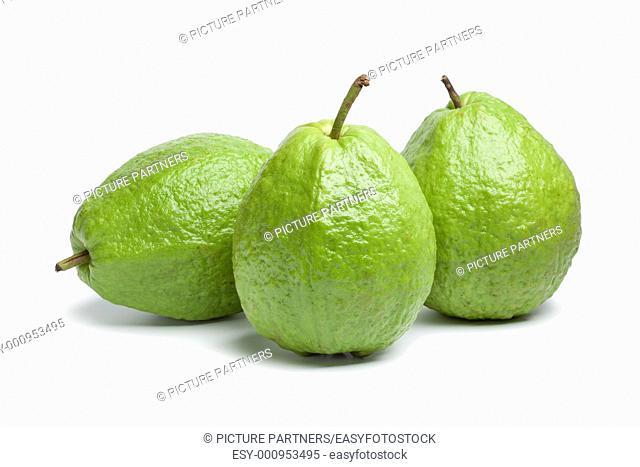 Whole fresh guava fruit on white background
