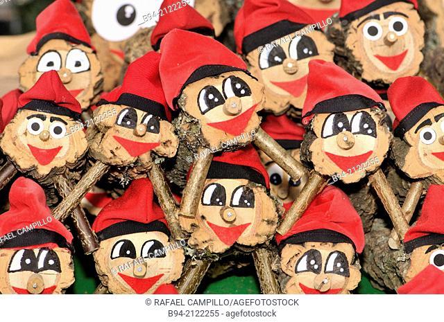 Tions de Nadal (Christmas logs), Catalan tradition, for sale at fair. Fira de Santa Llúcia, Barcelona, Catalonia, Spain