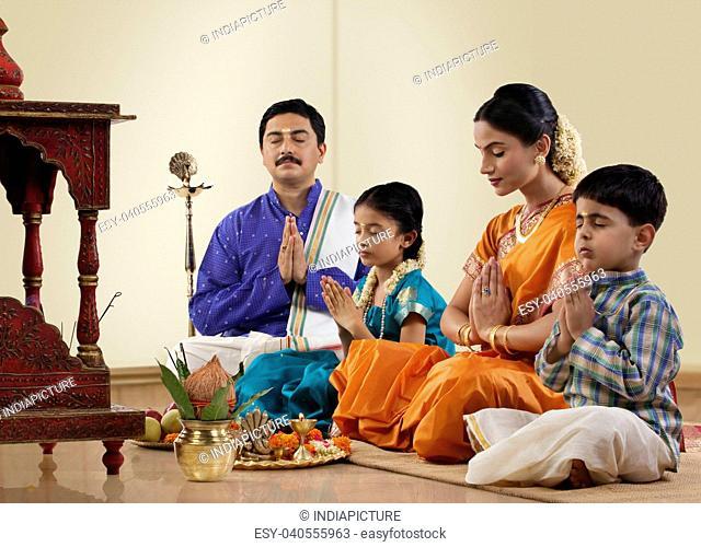 South Indian family praying