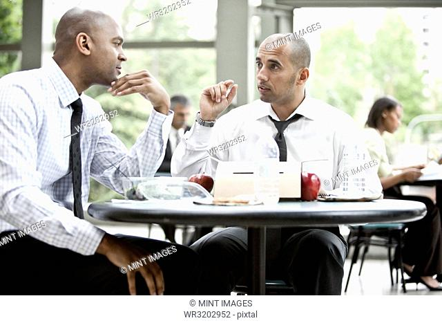 A black businessman and a middle eastern businessman having a business lunch