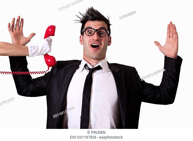 surprised businessman with red phone