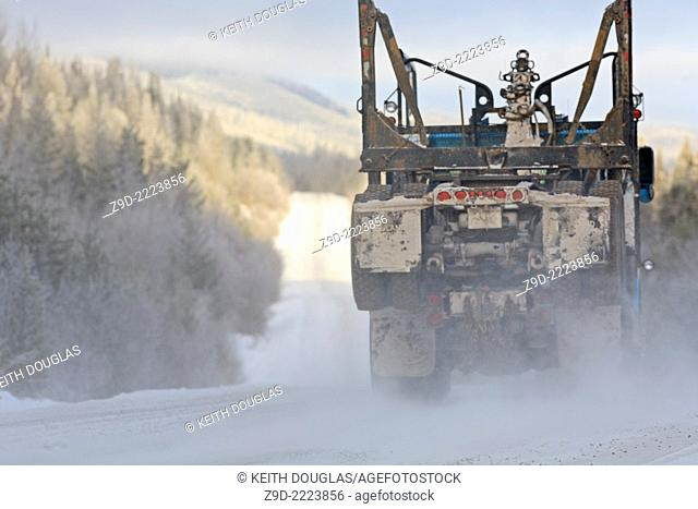 Empty logging truck heading back for another load, Smithers, British Columbia