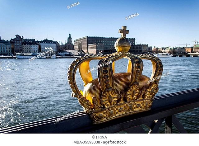 Skeppsholmsbron bridge, crown, gilded, view on Stockholm castle