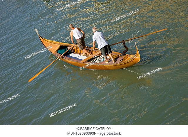 Two men training on a race gondola
