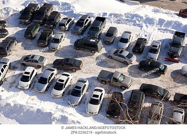 A construction parking lot seen from overhead in winter. Toronto, Ontario, Canada