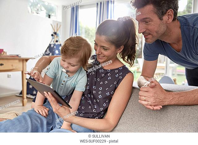 Happy family using tablet at home