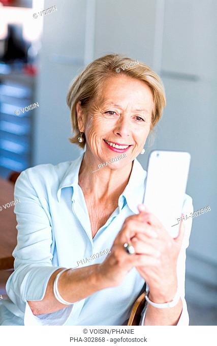 Woman using an iphone®