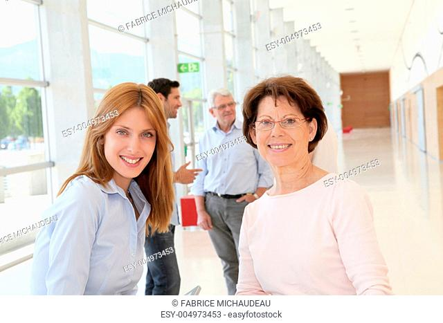 Portrait of smiling women in business training