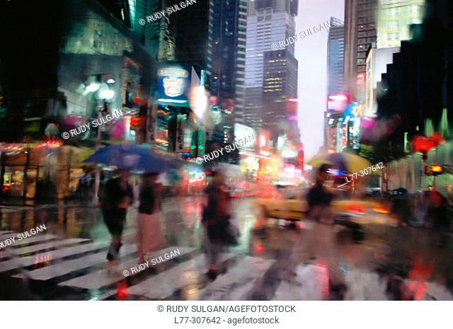 Pedestrians on Times Square in rain. New York City, USA